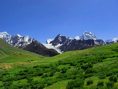 Broghil Pass and HinduRaj mountains (meansmuchtome) Tags: blue pakistan mountain snow mountains green ice beautiful grass asia glacier pastures peaks karumbar ishkoman hinduraj ishkomen
