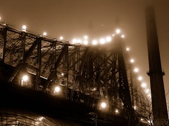 steel sepia (nj dodge) Tags: nyc longexposure bridge topf25 fog sepia night lights 500v20f manhattan steel listeningto bridges smokestack slowshutter eastside queensborobridge 59thstreetbridge bobdylanbiograph