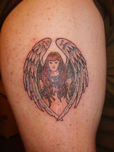 Tim Jr's Winged Woman Tattoo This is a