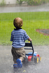 rain or shine (Ben McLeod) Tags: rain toy play liam lawnmower crocs toylawnmower 105mmf28gvrmicro tc49rain