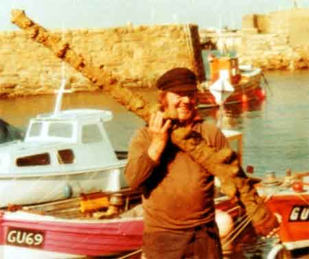 Fisherman Bertie Cosheril in 1977 with the concreted musket that led to the discovery of the Alderney wreck