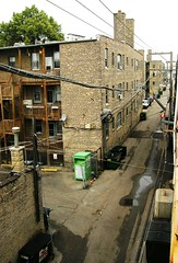 Summer Morning in the Alley (TheeErin) Tags: city urban chicago brick dumpster early wire cta platform citylife el wires transit porch montrose shelter telephonewire greenbox