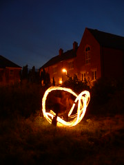 fire twirling (haveyouseenthisgirl) Tags: light party orange fire sticks exodus ashbourne
