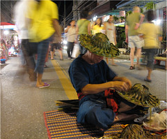 Chiang Mai Market (Alon_A) Tags: people motion hat night work thailand moving exposure nightshot market snapshot working mai chan chiangmai chiang yello changmai 86points interestingness174 abigfave peoplemotion aplusphoto