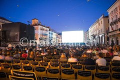 Film Festival Locarno (Mats Silvan) Tags: city light sky people cinema color building tower film festival architecture night movie square stars outdoors person switzerland ticino chair sittingdown projector dusk many crowd screen illuminated locarno bluehour rearview oldtown enjoyment filmfestival chir folm traveldestination swissculture filmfestivallocarno