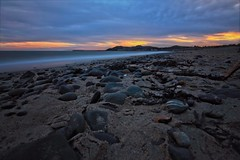 Sand, Sea and Stone (Colin Kavanagh) Tags: beach beachscape sand stones stone sea shore shoreline coastal coast evening sunset arklow wicklow longexposure ndfilter nd10 700d manfroto water sky clouds ireland