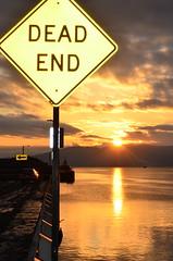 Dead End (James_D_Images) Tags: washingtonstate bellingham harbor waterfront dock deadend sign flash arrow sun clouds water reflection sunset sooc boat