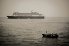 Volendam and boat (Macshoot) Tags: ship volendam cruise sea voyage boat indonesia