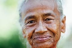 Smiling Old Woman Portrait, Java Indonesia (AdamCohn) Tags: adamcohn buleleng genteng indonesia java bokeh cataracts f12 oldwoman portrait smile smiling wrinkles wwwadamcohncom indonesian elderly kind nice happyplanet asiafavorites