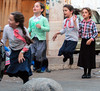 How long will people (in the West) be able to understand this photo? (ybiberman) Tags: israel jerusalem meahshearim girls jumping rope jumpingtherope playing skirt brade portrait candid streetphotography