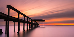 Dock of the Bay (cylynex) Tags: alabama sunset fall longexposure travel america usa dock pier silhouette reflections water mobilebay mobile al sky sreaks nikon d800 santocommarato