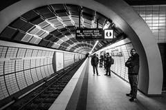 waiting at the station / U2 flair (Özgür Gürgey) Tags: 2017 20mm bw d750 hamburg hauptbahnhof nikon u2 voigtländer architecture station street subway germany
