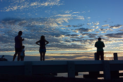 Silhouettes at Brighton Beach (Marian Pollock) Tags: australia victoria melbourne brightonbeach sunset clouds pier people summer colourful silhouette beach portphilipbay ocean dusk sun weather sky cloud