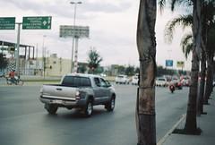 Rush hour, Durango (fisher.victor) Tags: road travel trees cars film sign 35mm mexico highway vehicles rush hour durango praktica mtl5