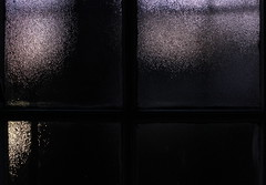 Through the looking glass (Michele's POV) Tags: darkly nightsecrets refraction distortion stippled darknessfalling lightless reflect enigma hushed obscure blackness nigtfall glass panes abstract abstraction