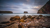 Golden beach (TanzPanorama) Tags: beach stones rock spain asturias seascape waterscape bayofbiscay bay costa aqua tanzpanorama sonya7ii fe1635mmf4zaoss sel1635z variotessartfe1635mmf4zaoss sony le sky playa playaballota sea clouds landscape shore seaside coastline coast dusk