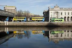 Colourful buses on Custom House Quay (Tawny042) Tags: d700 nikon city urban dublin quay river liffey customhouse bus colour bridge reflection ireland lovelycity