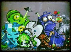 Newcastle Grafitti (hobbitbrain) Tags: door uk streetart color colour art newcastle paint grafitti aliens urbanart flyingsaucer padlock