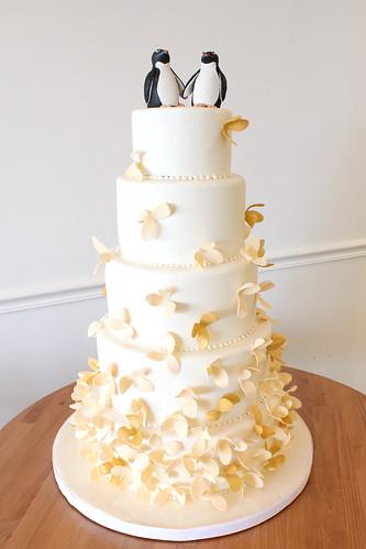 Penguin Wedding Cake with Peach Petal Flowers