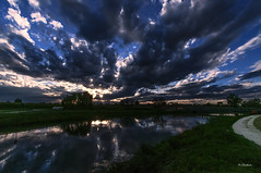 Stormy sky (G.hostbuster (Gigi)) Tags: sky clouds reflections river stormy ghostbuster gigi49