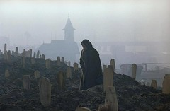 #A woman, standing between markers of fresh graves in a Sarajevo cemetery, mourns over the grave of a dead relative in the early morning, on January 17, 1993. by Hansi Krauss [1200 x 786] #history #retro #vintage #dh #HistoryPorn http://ift.tt/2hvjBFm (Histolines) Tags: histolines history timeline retro vinatage a woman standing between markers fresh graves sarajevo cemetery mourns over grave dead relative early morning january 17 1993 by hansi krauss 1200 x 786 vintage dh historyporn httpifttt2hvjbfm