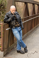 Rusty Bridge (octane-photo) Tags: cigars cigar cigarmen facialhair goatee goatees boots wesco leather gloves leathergloves jacket langlitz flannel officerstephens mustache mustaches mensmokingcigars mensmoking menwhosmokecigars smokingmen menwhosmoke