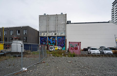 Art in the City (Jocey K) Tags: newzealand southisland christchurch cbd building archtiecture fence tags sky clouds cars carpark streetart mural artwork