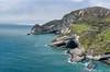 Cape Farewell Cliffs (ChiiPicts) Tags: newzealand southisland farewellspit capefarewell ocean water mountains landscape countryside cliffs