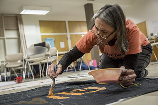 Beth Brockman Paints a Banner in Preparation for an Anti-Torture Demonstration