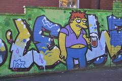 barney, the simspons (curly_em) Tags: cartoon pint beer purple yellow thesimpsons bristol somerset england graffiti streetart