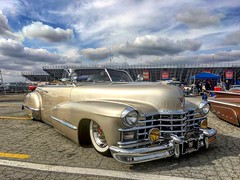 Cadillac rag top (El Cheech) Tags: lowlow rain gloomy sky clouds pomonafairplex pomonaswapmeet 40s whitewalls luxury bomb classiccar slammed lowrider lowered chrome 47caddy 1947 caddy cadd cadillac