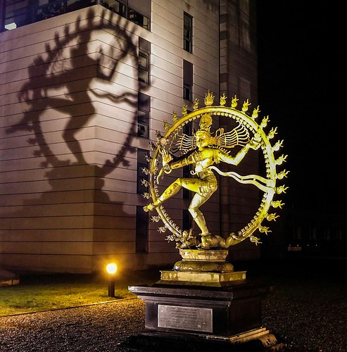 Statue of Shiva at CERN during a rainy February evening.