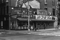 Corner Deli (colinpoe) Tags: blackandwhite spotmatic street streetphotography soho storefront 35mm hp5 nyc signs cornerdeli signage slr sign pentax supertakumar50mm rodinal laesquina gothamist rodinal125 bw ilford ilfordhp5 pentaxspotmatic