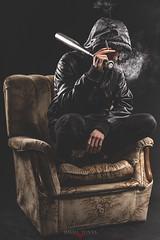 Brake Point (Isma Yunta) Tags: roja bat bate beisbol brake point lowlight low light sofa cuero leather black ring anillo smoke humo highclass style design street urban boy bad sit sentado raro solo portrait lonely retrato capucha hood