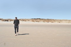 Walking on the beach (iamgiuliam) Tags: travel blue sea summer sky holiday man beach walking vlieland sand solitude alone desert wanderlust explore barefoot lonely discover