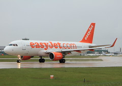 EasyJet Airbus A320 G-EZWK (Matthew Douglass Aviation) Tags: uk sky orange holiday man wet plane canon airplane manchester eos fly flying airport wings aviation air jets airplanes transport flight wing jet engine aeroplane airline 7d planes airbus easy airports airlines takeoff runway airliner aeroplanes aero easyjet airliners airfield a320 egcc