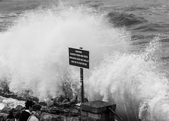 High Seas (EightBitTony) Tags: ocean uk sea england blackandwhite bw water monochrome sign danger warning landscape blackwhite seaside unitedkingdom wave spray gb scarborough footpath northyorkshire warningsign highsea