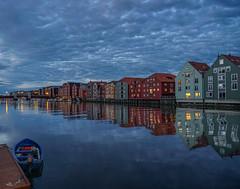 blue sunset on the river Nidelva (krøllx) Tags: blue houses sunset reflection nature water colors norway clouds landscape boat colorful simple trondheim warehouses nidelva bakklandet trøndelag 1508090111