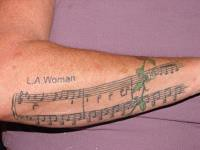 SHEET MUSIC (fungrammyz) Tags: tattoos sheetmusic forearm lawoman