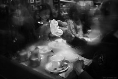 lemme see (jrockar) Tags: streetphotography london street streetphoto candid moment instant snap decisive through glass window fog steam man cleaning wiping wipe napkin hand bw mono blackandwhite canon 5d mk mark iii 3 l 1740 restaurant table outsidein people jrockar janrockar idiot ordinary madness ordinarymadness