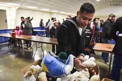 Sailor searches for a specific stuffed animal request for a child during the Toys for Tots. (Official U.S. Navy Imagery) Tags: cnrnw marines christmas toysfortots usmc bremerton wash unitedstates
