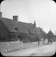 img638 (foundin_a_attic) Tags: antique magic lantern slides glass vintage fashion thatch house cotage hourse cart stone wall windows chimney