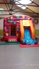 Celebration themed 18x12 combo, bouncy castle and slide in one. Suitable for up to 10 year olds. Only £75 per hire.
