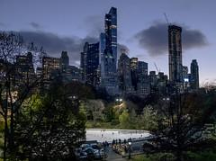 City Skaters (1hr photo) Tags: nyc newyork manhattan centralpark iceskating iceskaters icerink essexhouse skyline cityscape wolmann trump w59thst