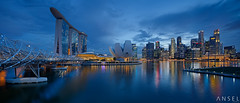 Shift City (draken413o) Tags: city travel blue sunset urban panorama skyline architecture night marina canon lights bay singapore asia skyscrapers cityscapes shift places hour sands tilt destinations 17mm