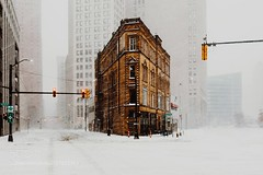 Stormin' Norman (l3v1k) Tags: ifttt 500px winter street downtown cold minimal buildings urban cityscape snow empty lines moody december tracks windy covered corner sky scrapers explore flat iron storm vantage point white out low visibility architecture city detroit michigan no traffic cadillac square