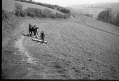 img062 (foundin_a_attic) Tags: black white negtive fashion farmer hourses hourse plough field trees hege dirt vintage