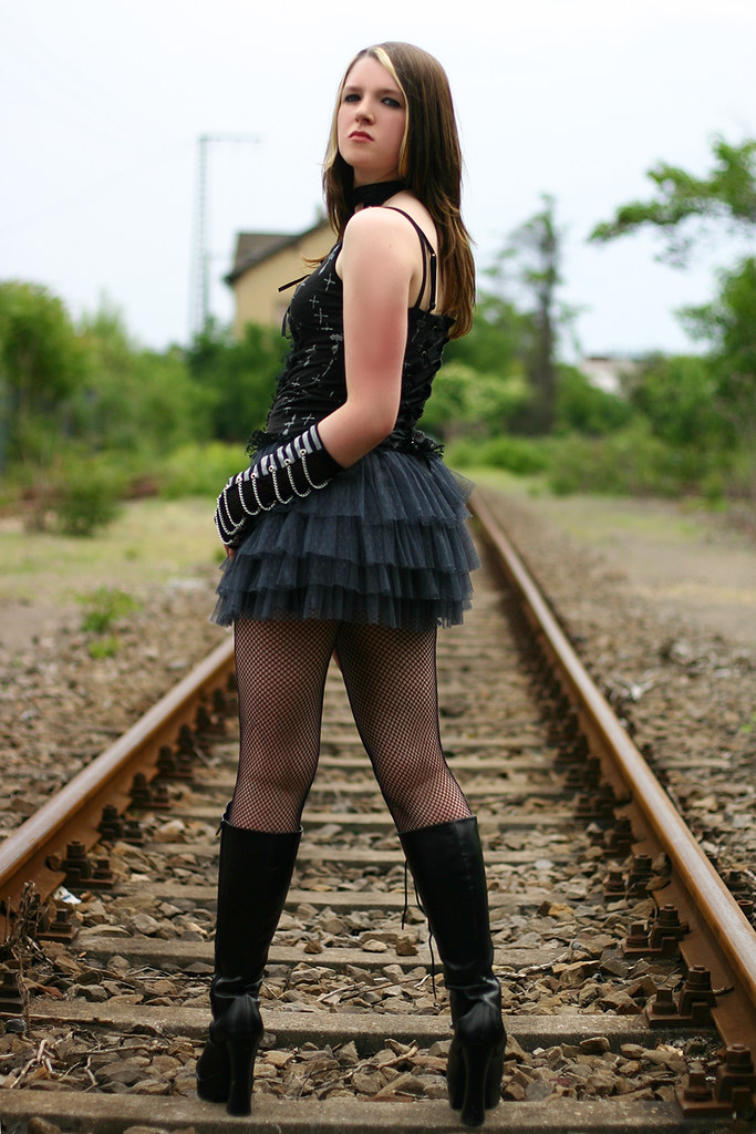 Tight goth teen in leather corset and boots