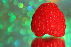 Raspberry Beret (alideniese) Tags: macromondays inspiredbyasong macromondaysinspiredbyasong macro closeup raspberry bokeh fruit berry red green colour colourful raspberryberet reflection