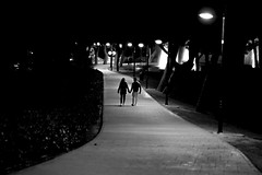 Love in the park (Daniel Nebreda Lucea) Tags: park parque two dos couple love amor woman mujer man hombre path paso camino forest bosque city ciudad night noche black white blanco negro monochrome monocromo urban urbano canon 50mm travel viajar zaragoza aragon europe shadows sombras lights luces lines lineas curves curvas composition composicion nature naturaleza siluetas dark oscuridad walking andando atmosphere atmósfera silence silecio beautiful perspective perspectiva life vida